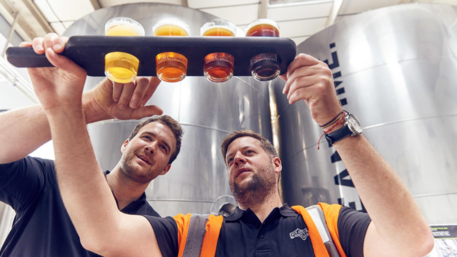 Brewers check the latest batch of brews at Meantime Brewery on Greenwich Peninsula.