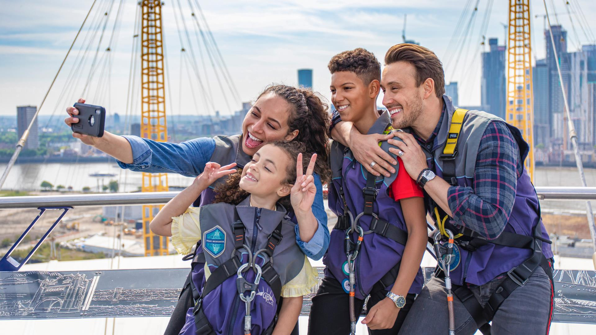 A family take a selfie at Up at The O2 as part of their Greenwich itinerary.