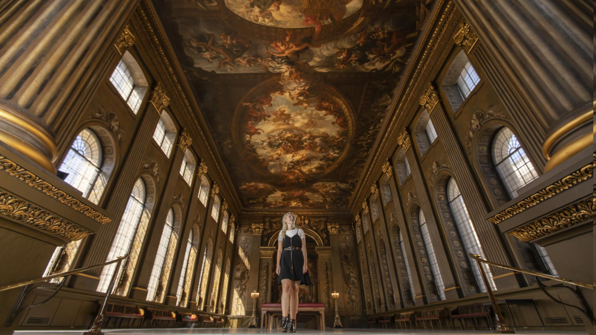A girl marvels at the ceiling at the Painted Hall at the Old Royal Naval College in Greenwich.