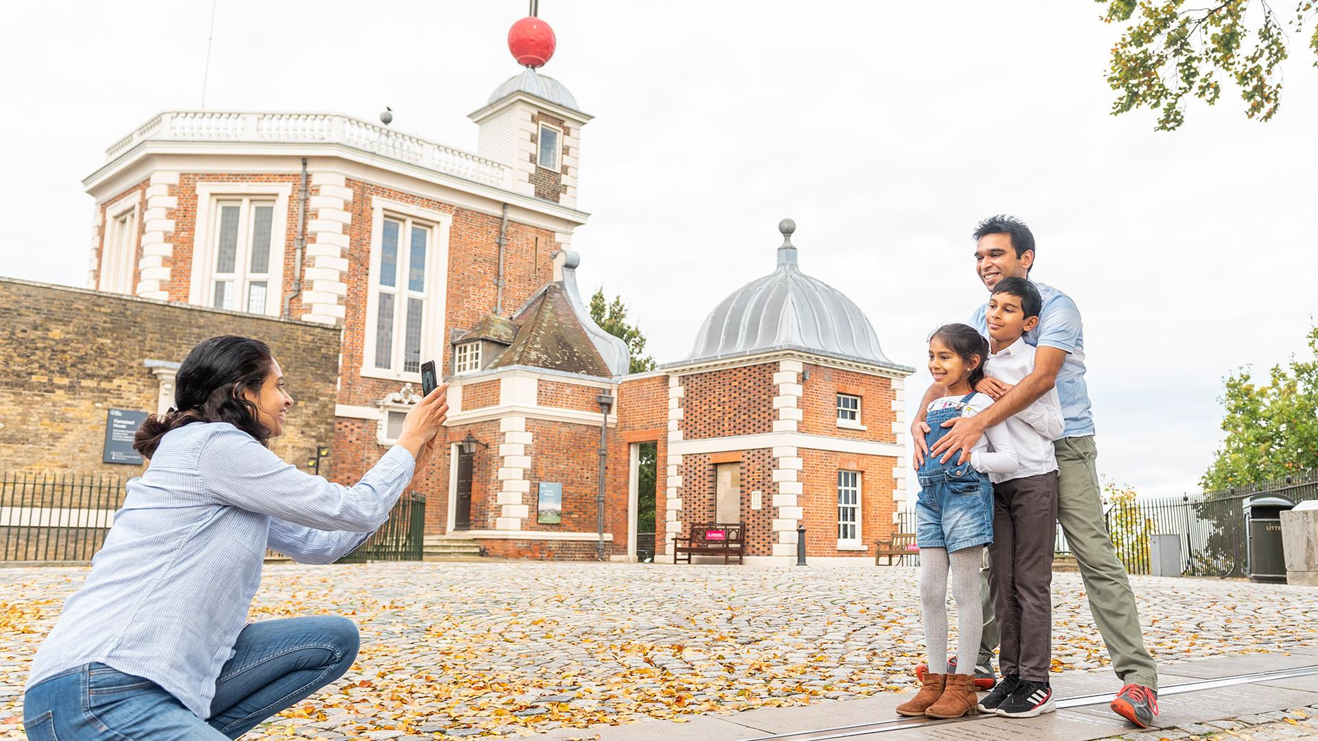 A family on the Meridian Line at the Royal Observatory in Greenwich.