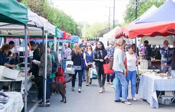 A great picture of Blackheath Market, showing rows of stalls filled with farmers produce.