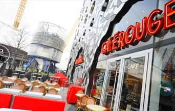 The exterior of Cafe Rouge on Greenwich Peninsula showing The O2 in the background.