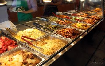 Inside China City Woolwich showing a buffet table filled with food.