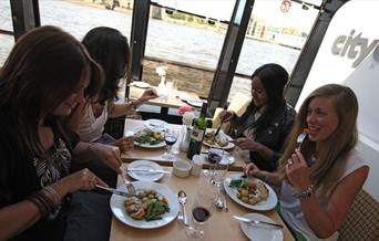 Four ladies enjoying their lunch onboard City Cruises Lunch Cruise.