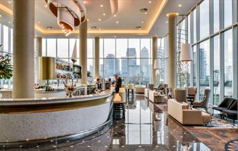 The Clipper Bar at the InterContinental London - The O2. With floor to ceiling windows that overlook the river Thames and Canary Wharf.