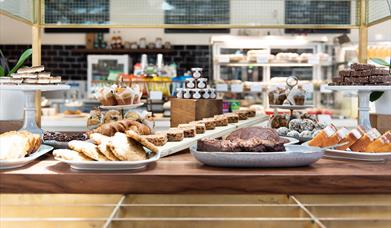 Inside the Cutty Sark Café, showing a room filled with delicious snacks.