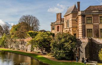 Eltham Palace surrounded by the beautiful gardens and moat.