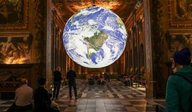 Luke Jerram's awe-inspiring art installation Gaia which is an internally-lit globe sculpture is displayed in the centre of the Painted Hall.