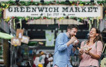 A couple enjoying their food at Greenwich Market Food Court.