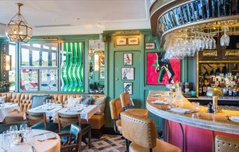 The interior of The Ivy Cafe, Blackheath is decorated with the theme of kites, as the area is well known for its popularity with kite-fliers and kit-s