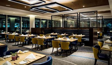 The luxurious interiors of the Market Brasserie at InterContinental London - The O2, overlooking Canary Wharf.