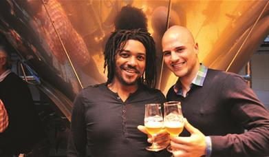 Two guys enjoy a sample of beer on a Meantime Brewery Tour in Greenwich.