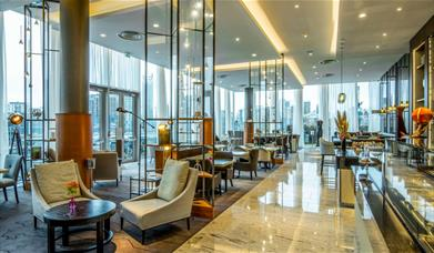 The bright and airy Meridian Lounge at InterContinental London - The O2 has stunning views through the floor to ceiling windows of the river Thames an