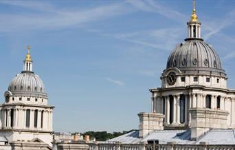 Image of two domes above Old Royal Naval College.