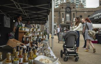 People stop to look at the range of goodies on offer at Royal Arsenal Farmers Market in Woolwich, Greenwich.