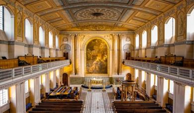 The beautiful neoclassical interior of the Chapel of St Peter and St Paul at the Old Royal Naval College in Greenwich.