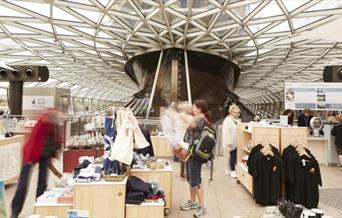 Inside The Cutty Sark Gift Shop, showing a wide range in souvenirs spread across the ground floor.
