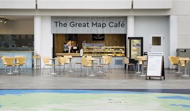 The Great Map Café, located inside the National Maritime Museum. In the picture you can see the café with a range of treats and lots of seating.