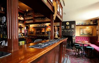 The beautiful old wooden bar at The Plume of Feathers in Greenwich.