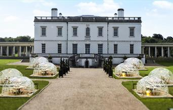 A stunning picture facing towards the queens house, featuring 8 Dining Domes. Each dome has a table and chairs and offers a 360 degrees view.