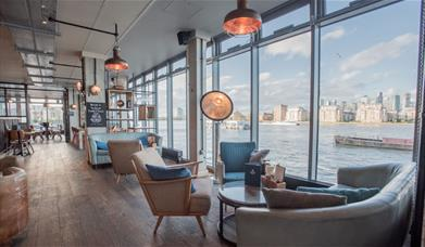 The Sail Loft has panoramic views of the river Thames from its floor to ceiling windows.