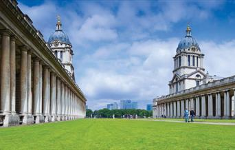 The University of Greenwich on green grass with blue sky
