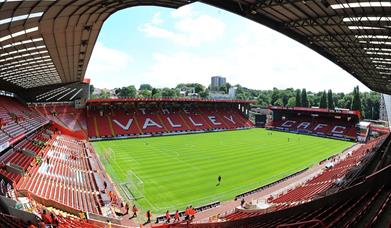 Looking down into Charlton Athletic ground, The Valley on a sunny day with no crowds.
