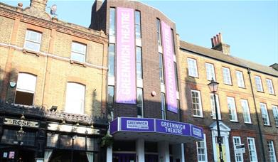 Greenwich Theatre is based in a three story brick building, with Greenwich Theatre sign in a purple background with white words going vertically up to