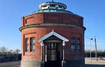 A guard house looking, red brick Woolwich Foot Tunnel entrance.