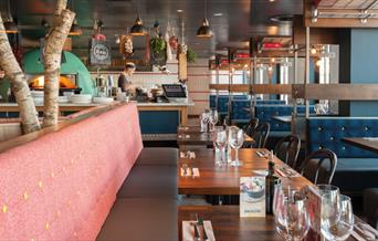 At Zizzi, Greenwich Pier, you can sit and watch as they prepare your food from their open kitchen with pizza oven.